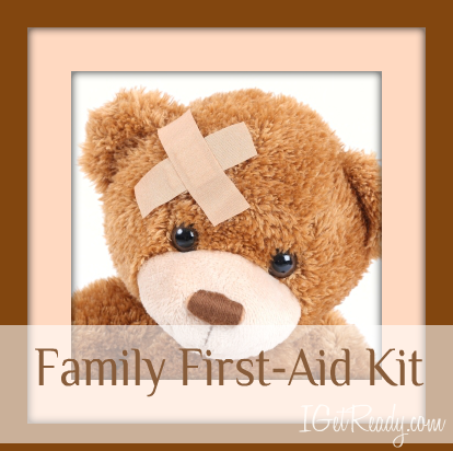Teddy Bear with bandaids, and watermark that says Family First-Aid kit