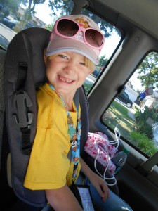 My Daughter in her bright yellow shirt, ID lanyard and Princess hat and shades.